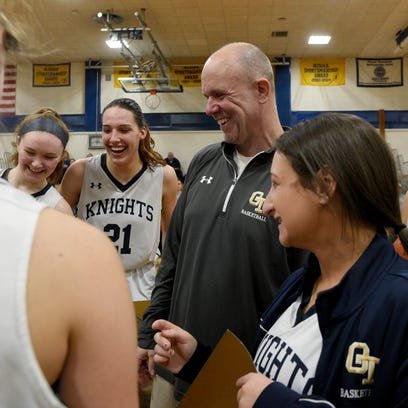 Old Tappan girls basketball coach Brian Dunn is surrounded