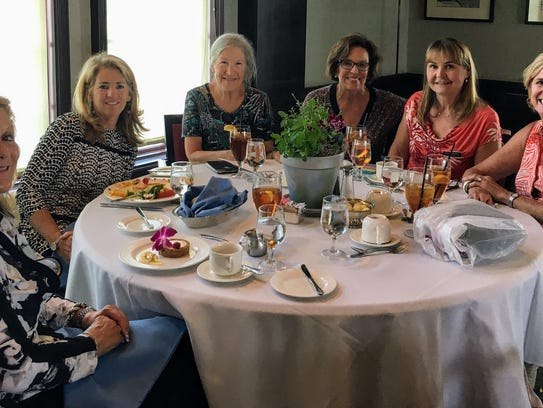 New members with Nancy Traiser at April luncheon.