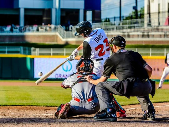 Austin Davis ,23, of the Lugnuts hits an RBI single to put Lansing up 10-1 in the bottom of the 6th inning of their game Wednesday June 15, 2016 at Cooley Law School Stadium in Lansing.