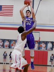 TCA's Sergio Pagoaga pulls up for a jumpshot over a USJ defender during their game, Saturday evening at USJ.