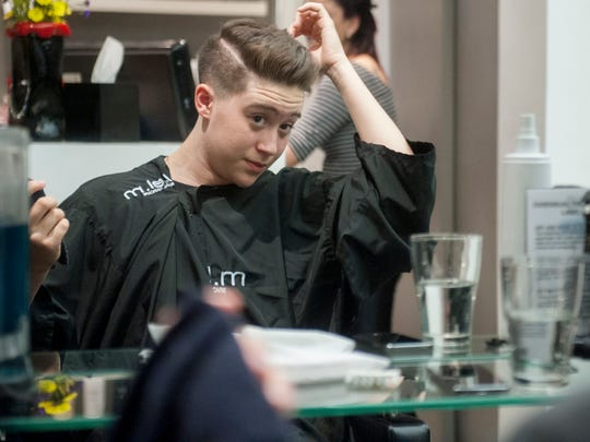 Matt Dawkins a 17-year old transgender male from Marlton, inspects his new hairstyle that he received at Essensuals London Hair Salon in the Cherry Hill Mall. 04.02.15