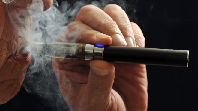 Torin Halsey, AP In this photo illustration, a smoker puffs on an e-cigarette. E-cigarettes are being touted as a safe alternative to traditional lighted tobacco products. Studies are looking at the chemical makeup of the secondhand vapor which is breathed out like smoke. (AP Photo/Wichita Falls Times Record News, Torin Halsey) ORG XMIT: TXWIC103