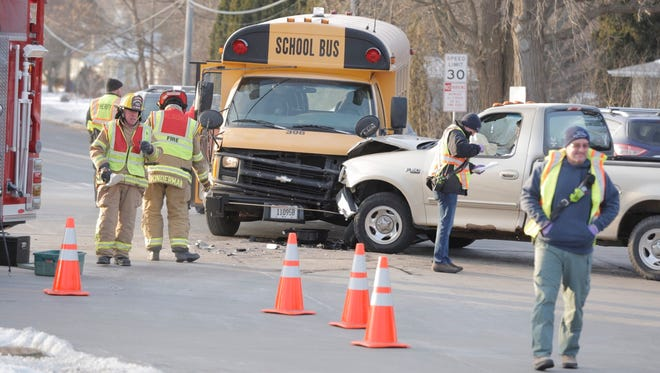 Emergency crews respond to a crash involving a school bus and a pickup truck Thursday, Jan. 5, 2017, at the intersection of Witzel Avenue and Oakwood Road in the town of Algoma.