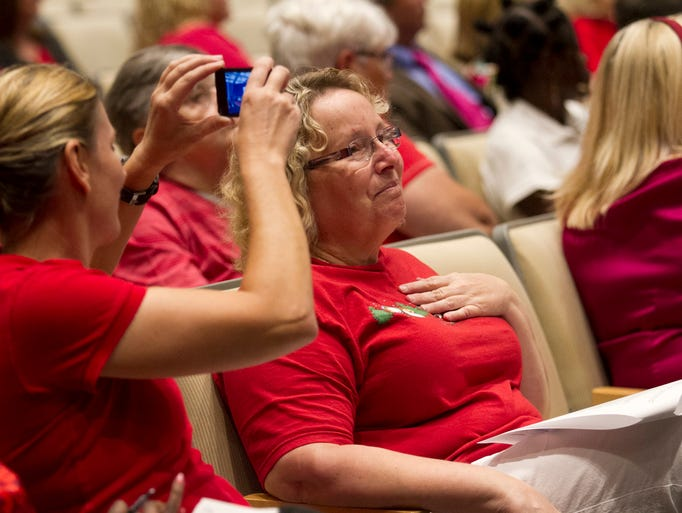 Debbie Mazzola, center, reacts to those speaking in support of the domestic partnership registry at the Cape Coral City Council meeting on Monday while Cori Craciun, left, records the public comments.