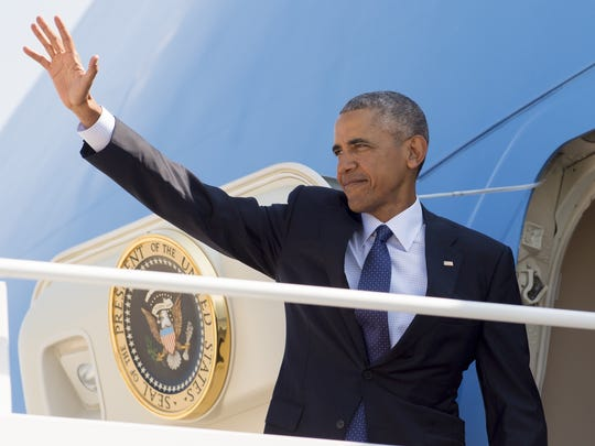 President Obama waves from Air Force One prior to departing