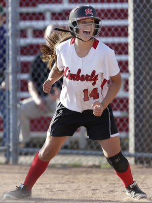 Kimberly High School's No. 14, Jenna Smarzinski, celebrates during a May 29, 2014 game in Kimberly. Smarzinski and the rest of the Papermakers softball team head to state next week.