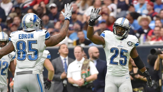 Lions running back Theo Riddick celebrates his 1-yard touchdown pass with teammate Eric Ebron during the second half against the Houston Texans, Sunday, Oct. 30, 2016, in Houston.