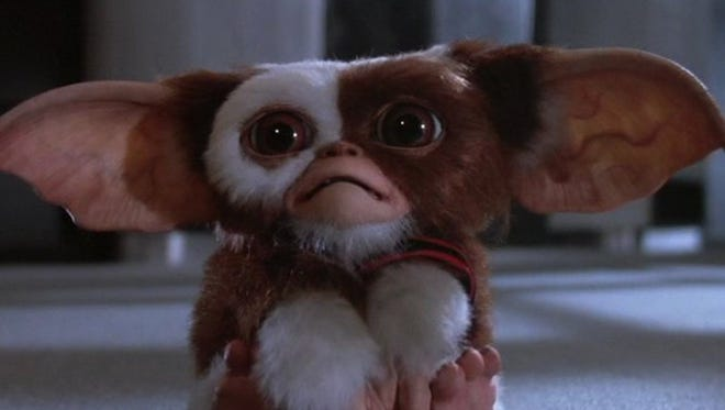 """Gizmo and his less cute colleagues star in """"Gremlins,""""  one of the family-friendly Halloween movies  screening Saturday and Sunday during the free """"Pandemonium Cinema Showcase"""" at Cossitt Library."""