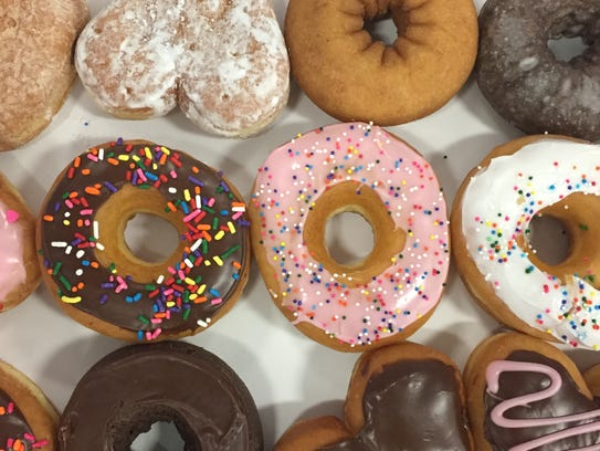 A box of doughnuts from Dunkin Donuts.