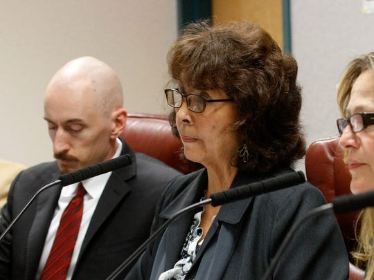 Valerie Espinoza, right, listens to complaints from AV Water customers, Wednesday, Oct. 12, 2016, during a hearing at the San Juan County  Administration Building in Aztec.