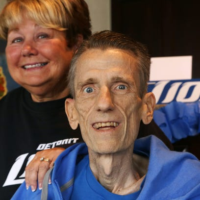 Detroit Lions fan Chris Liwak, right, and his sister