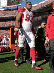 Arizona Cardinals defensive end Calais Campbell (93) leaves the game against the Denver Broncos, Sunday in Denver.