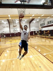 Madison junior forward Santi Quintero goes up for a layup during practice.