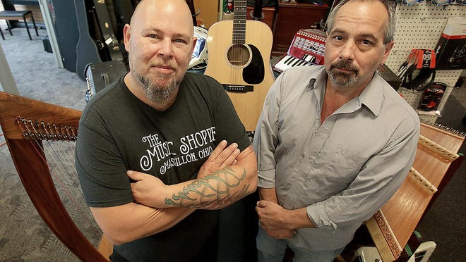 John Soptelean (left), repair and service technician at The Music Shoppe, and owner Bob Jones (right) are pictured Thursday inside the shop's new home at 54 Federal Ave. NE, Massillon. The music store offers instruments for sale and rent, in addition to the service and installation of music equipment.