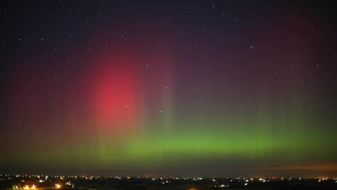 The Northern Lights shine over Forest City, Iowa, in the early morning of Tuesday, Nov. 3, 2015.