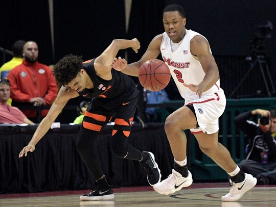 Marist guard Brian Parker steals the ball from Oregon State guard Stephen Thompson Jr. at the AdvoCare Invitational last season.