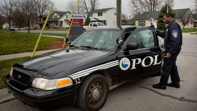 Port Huron Police Cadet Jamie Brown, of Port Huron, gets back into his cruiser while serving a subpoena Wednesday, Dec. 16, 2015 in Port Huron. The department has received two $6,000 grants from the Community Foundation of St. Clair County to cover the cost of sending cadets to the police academy.