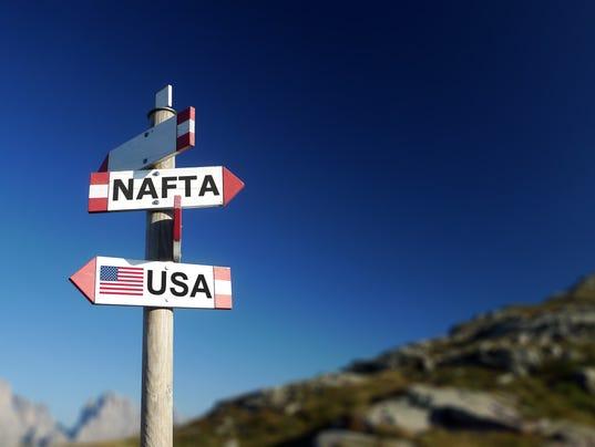 Modernize nafta louisvilles gli urges trump in letter nafta agreement written on signpost in mountains negotiations concept withdrawal concept platinumwayz