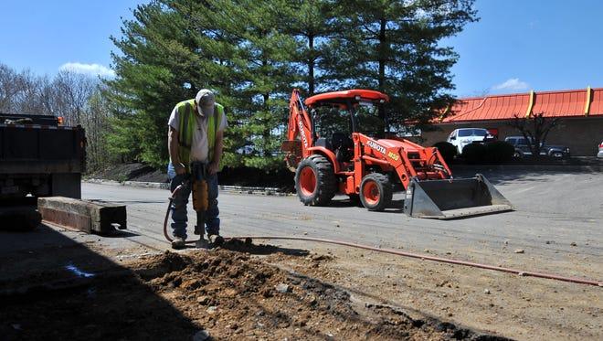 Lancaster Municipal Gas workers spent the afternoon patching a gas line at Plaza Shopping Center Monday, April 13, 2015. Several businesses were evacuated after the line was hit by at construction crew.