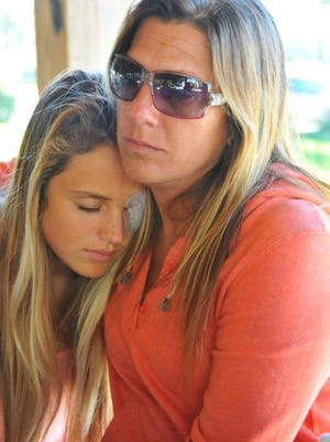 Storm Portman, left, and her mother, Toye Hall. Storm has undergone two surgeries on her injured eye.