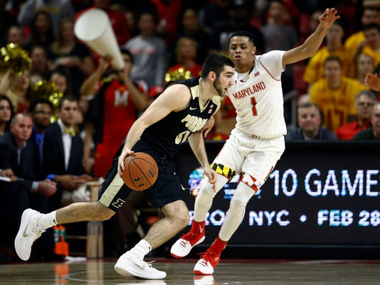 Purdue guard Dakota Mathias, left, drives past Maryland guard Anthony Cowan in the second half of an NCAA college basketball game in College Park, Md., Friday, Dec. 1, 2017. (AP Photo/Patrick Semansky)