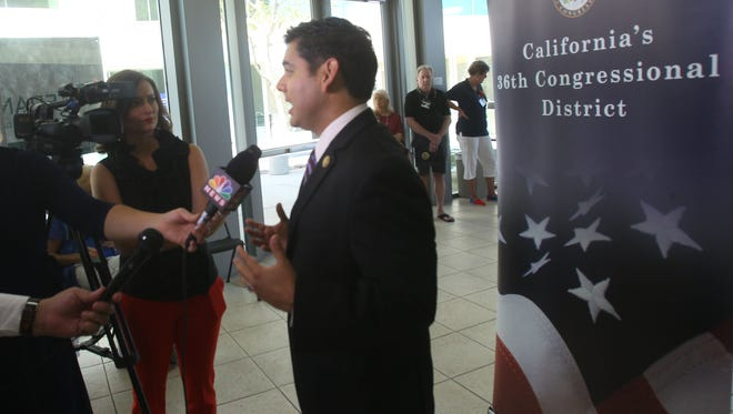Rep. Raul Ruiz speaks to a reporter during his 2016 Veterans University event. Rep. Ruiz says he will not attend Friday's inauguration of Donald Trump.