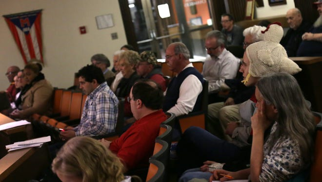 People watch from the gallery of a Mansfield City Council meeting about the proposed chicken legislation.