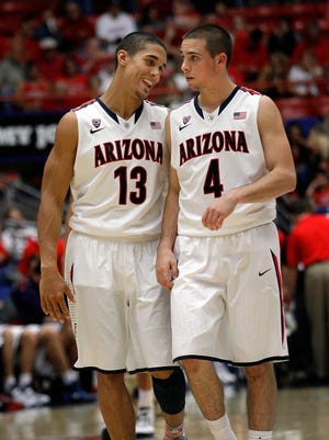 Arizona's Nick Johnson (13)and T.J. McConnell (4) share a laugh before the start of the second half against Fairleigh Dickinson in an college NCAA basketball game.
