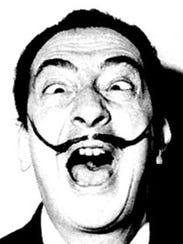 Artist Salvador Dali strikes a familiar pose.