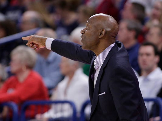 Portland coach Terry Porter directs his team during the first half of an NCAA college basketball game against Gonzaga in Spokane, Wash., Thursday, Jan. 11, 2018. (AP Photo/Young Kwak)