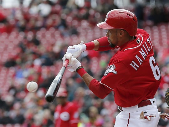 Reds center fielder Billy Hamilton hits a double to