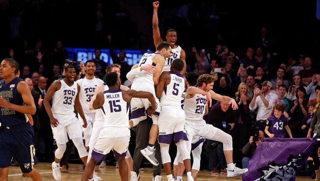 TCU players celebrate after defeating Georgia Tech in the championship game of the 2017 NIT at Madison Square Garden.