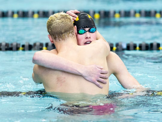 Avon High School junior Parks Jones, left, celebrates winning the 500 Yard Freestyle event with teammate Grant Sprout, who finished  second.