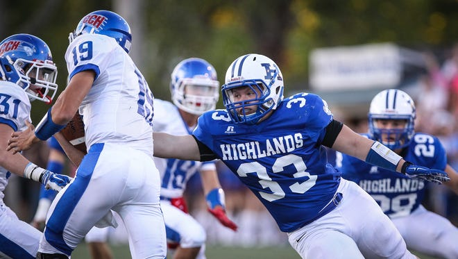 Highlands' Patrick Schoepf has his eye on a sack as he goes after CovCath quarterback Adam Wagner during the first quarter Friday.