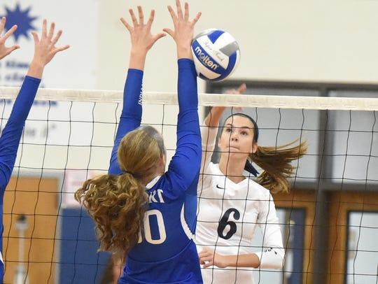 Robert E. Lee's Jennifer Williams spikes the ball during