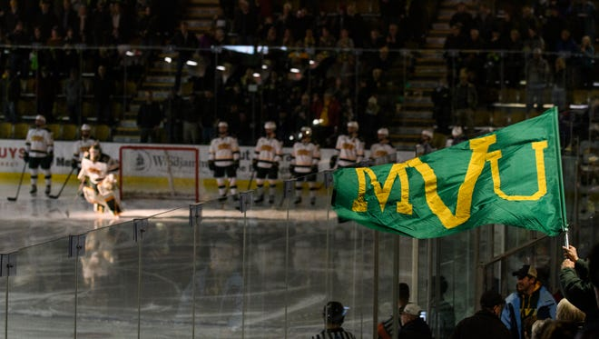 A Vermont fan waves a flag during player introductions during the men's hockey game between the Northeastern Huskies and the Vermont Catamounts at Gutterson Fieldhouse on Friday night February 16, 2018 in Burlington.