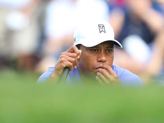 tiger-woods-struggles-first-round