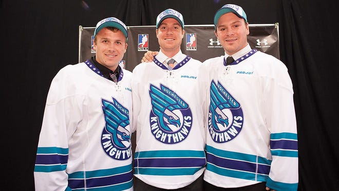 New Knighthawks, from left to right, John St. John, Brad Gillies and Derek Searle pose after Monday night's NLL Entry Draft. Gillies and Searle played at RIT.