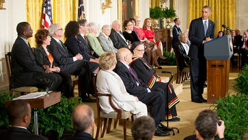 President Barack Obama, right, speaks before awarding the Presidential Medal of Freedom, Monday, Nov. 24, 2014, during a ceremony in the East Room of the White House in Washington. President Obama is presenting the nation's highest civilian honor to 19 artists, activists, public servants and others. (AP Photo/Pablo Martinez Monsivais)