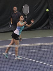 Shivane Chawla and Todd Friend won their mixed doubles division in the 84th News Journal/Richland Bank/matchmatetennis.com Tennis Tournament at Lakewood Racquet Club.