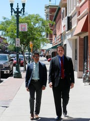 Rudy Vasquez, marketing and communications manager for the Downtown Management District, and Joe Gudenrath, the district's executive director, walk along South El Paso Street, which the DMD has branded El Centro shopping district. The DMD has launched a new marketing campaign tied to the Spanglish tagline: Authentico.