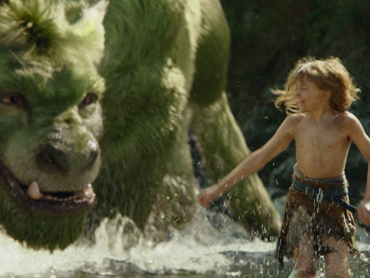 """Pete (Oakes Fegley) and Elliot play in """"Pete's Dragon."""""""