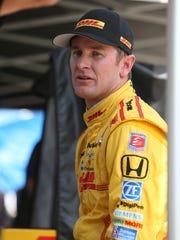 Ryan Hunter-Reay, driver of the DHL Honda, waits on