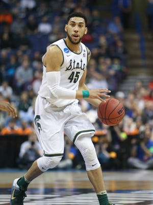 Michigan State Spartans Denzel Valentine drives against the Middle Tennessee State Blue Raiders during second half action on Friday, March 18, 2016 at Scottrade Center in St. Louis.
