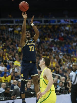 Derrick Walton Jr. shoots over Oregon guard Payton Pritchard during the first half of Michigan's 69-68 loss in the NCAA tournament March 23, 2017 in Kansas City.