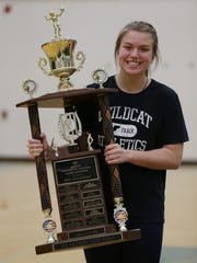 Novi's Erin O'Leary poses with the 2017 Miss Volleyball trophy.