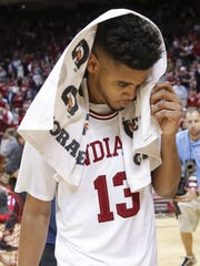 Juwan Morgan (13) walks off the court following the