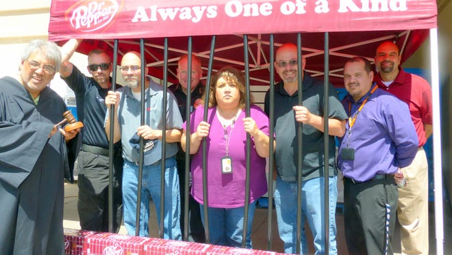 Ruidoso's police and fire chiefs, and Lincoln County Commissioner Dallas Draper were among the VIPs jailed Thursday to raise bail money that will benefit the Toys for Tots program this holiday season. The event was staged by members of the Survivors Clean and Sober Motorcycle Club.