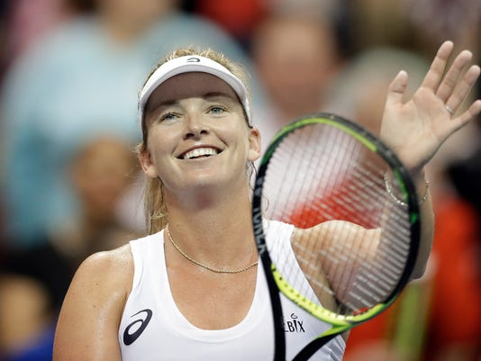 USA's Coco Vandeweghe celebrates after defeating Netherlands' Richel Hogenkamp during a match in the first round of Fed Cup tennis competition in Asheville, N.C., Saturday, Feb. 10, 2018. (AP Photo/Chuck Burton)