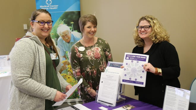 Whitney Drury, a Jackson State Occupational Therapy Assistant Student, and Cassie Duggan, Business Development Coordinator at Brookdale Jackson Oaks, talked with Laura Pate of the Alzheimer's Association, during the Eighth Annual Alzheimer's Caregiver Conference on the campus of Union University on February 21, 2018.